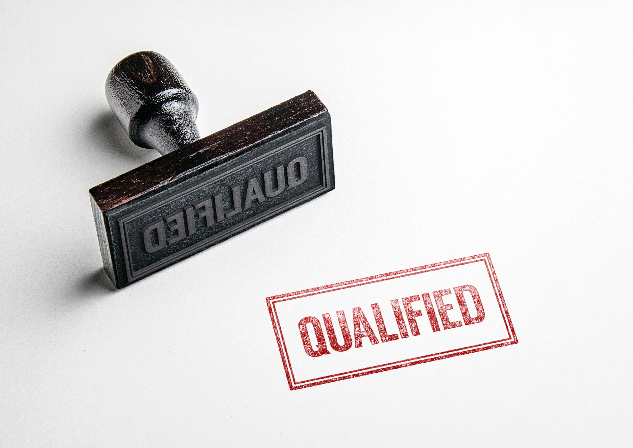Rubber,Stamping,That,Says,'qualified'.
